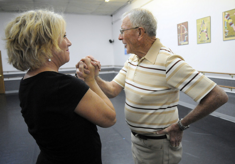 Dr. Bill Markel and Heidi Thomas have a warm char after their rehearsal for Dancing with the Broomfield Stars.<br /> <br /> September, 2010<br /> staff photo/David R. Jennings