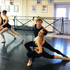 Natalie Roubique ( Alice) dances with Christopher Darling while Rebecca Terry and Olivia Neilands dance in the background during rehearsal for Danse Etoilte Ballet's  Alice in Wonderland on Thursday. <br /> <br /> May 17, 2012 <br /> staff photo/ David R. Jennings