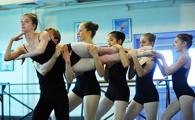 MacKenzie Ramsey, 14, ( The Catapillar) is carried by dancers as the legs during rehearsal for Danse Etoilte Ballet's  Alice in Wonderland on Thursday.   May 17, 2012  staff photo/ David R. Jennings