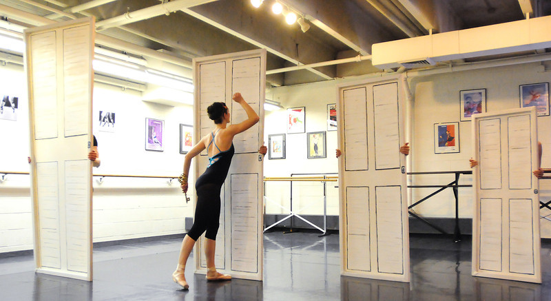 Natalie Roubique (Alice) tries to open doors during rehearsal for Danse Etoilte Ballet's  Alice in Wonderland on Thursday. <br /> <br /> May 17, 2012 <br /> staff photo/ David R. Jennings