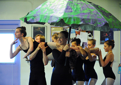 MacKenzie Ramsey, 14, ( The Catapillar) is carried by dancers from under a mushroom, Stacey Gibbs during rehearsal for Danse Etoilte Ballet's  Alice in Wonderland on Thursday.   May 17, 2012  staff photo/ David R. Jennings