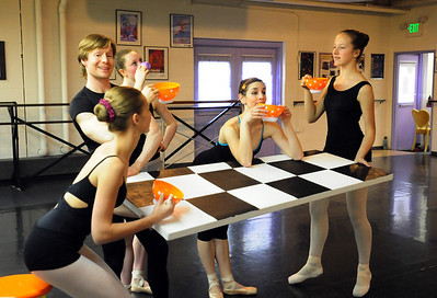 Sitting at the Mad Hatters table Olivia Neilands, 15, left, Christopher Darling,  Rachel Dreher, 14, Natalie Roubique (Alice) and Rebecca Terry, 14, during rehearsal for Danse Etoilte Ballet's  Alice in Wonderland on Thursday.   May 17, 2012  staff photo/ David R. Jennings