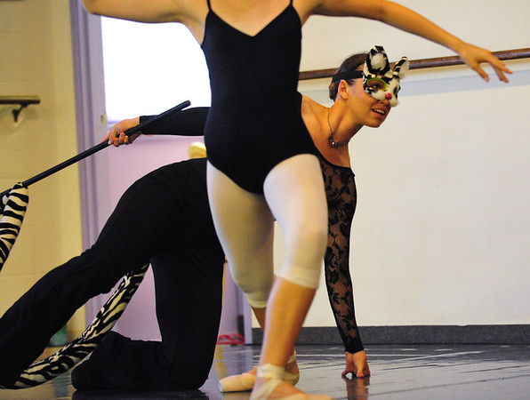 Stacey Gibbs (Cheshire Cat) looks around a dancer during rehearsal for Danse Etoilte Ballet's  Alice in Wonderland on Thursday. <br /> <br /> May 17, 2012 <br /> staff photo/ David R. Jennings