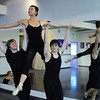 Tess Victoria ( the Queen) is carried by Christopher Darling, left, and Cooper Ramsey  during rehearsal for Danse Etoilte Ballet's  Alice in Wonderland on Thursday. <br /> <br /> May 17, 2012 <br /> staff photo/ David R. Jennings