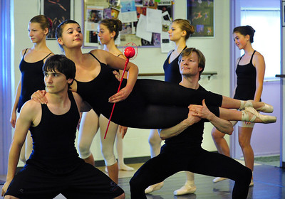Cooper Ramsey, 16, left, and Christopher Darling, right, carry Tess Victoria, 17, ( the Queen) during rehearsal for Danse Etoilte Ballet's  Alice in Wonderland on Thursday.   May 17, 2012  staff photo/ David R. Jennings