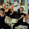 Cooper Ramsey, 16, left, and Christopher Darling, right, carry Tess Victoria, 17, ( the Queen) during rehearsal for Danse Etoilte Ballet's  Alice in Wonderland on Thursday. <br /> <br /> May 17, 2012 <br /> staff photo/ David R. Jennings