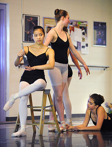 Meagan Knox,13, center, is painted by Amanda Greenino, 17, left, and  Rachael Jacobs,13, during rehearsal for Danse Etoilte Ballet's  Alice in Wonderland on Thursday.   May 17, 2012  staff photo/ David R. Jennings