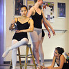 Meagan Knox,13, center, is painted by Amanda Greenino, 17, left, and  Rachael Jacobs,13, during rehearsal for Danse Etoilte Ballet's  Alice in Wonderland on Thursday. <br /> <br /> May 17, 2012 <br /> staff photo/ David R. Jennings