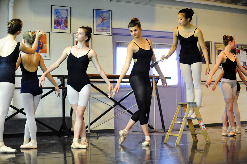 Dancers pose as roses being painted during rehearsal for Danse Etoilte Ballet's  Alice in Wonderland on Thursday. <br /> <br /> May 17, 2012 <br /> staff photo/ David R. Jennings