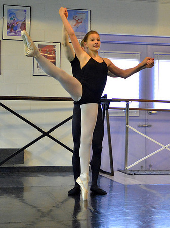 Kiera O'Neill, 13, dances with Christopher Darling while rehearsing for Danse Etoile Ballet's season opening production, Celebrate Dance and Music.<br /> August 17, 2012<br /> staff photo/ David R. Jennings