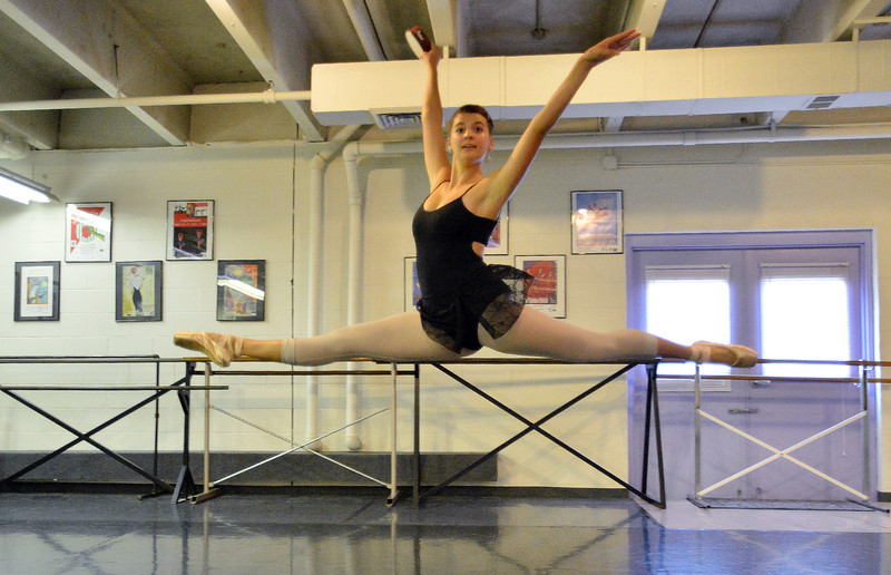 Tess Victoria leaps in the air while rehearsing for Danse Etoile Ballet's season opening production, Celebrate Dance and Music.<br /> August 17, 2012<br /> staff photo/ David R. Jennings