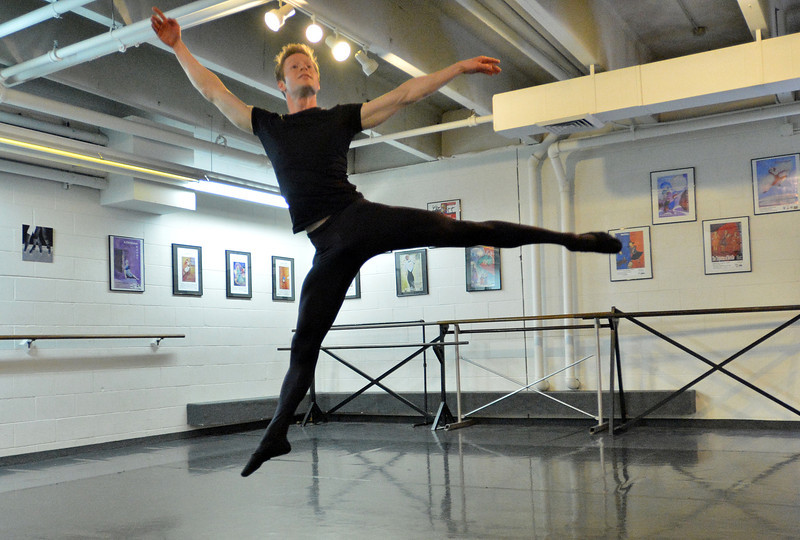 Christopher Darling leaps in the air while rehearsing for Danse Etoile Ballet's season opening production, Celebrate Dance and Music.<br /> August 17, 2012<br /> staff photo/ David R. Jennings