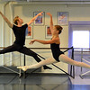 Christopher Darling, left, leaps in the air with Kiera O'Neill, 13, while  rehearsing for Danse Etoile Ballet's season opening production, Celebrate Dance and Music.<br /> August 17, 2012<br /> staff photo/ David R. Jennings