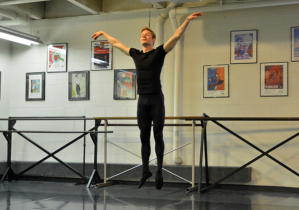 Christopher Darling leaps in the air while rehearsing his dance for Danse Etoile Ballet's season opening production, Celebrate Dance and Music.<br /> August 17, 2012<br /> staff photo/ David R. Jennings