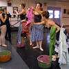 The maidens Brittany Mohler, center, Sophie Payannet and Michelle Yonsen hang laundry while Alex Eddy as Jiminy Cricket and Cooper Ramsey watch during rehearsal for the Danse Etoile Ballet production of Pinnochio on Monday.<br /> May 23, 2011<br /> staff photo/David R. Jennings
