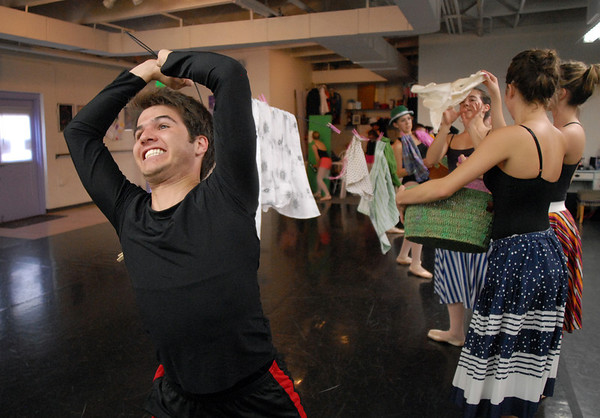 Adam Williams tries to keep the cloths line tight while the maidens put laundry on the line during rehearsal for the Danse Etoile Ballet production of Pinnochio on Monday.<br /> May 23, 2011<br /> staff photo/David R. Jennings