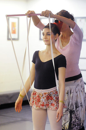 Natalie Roubique as Pinnochio is controlled by Cecile Kyriakos as Gepetto during rehearsal for the Danse Etoile Ballet production of Pinnochio on Monday.<br /> May 23, 2011<br /> staff photo/David R. Jennings
