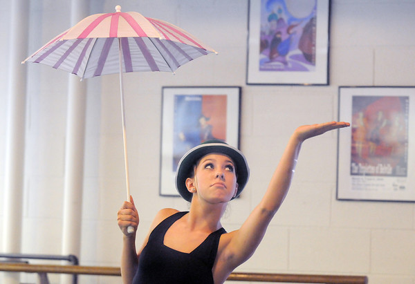 """Alex Eddy dances in the """"rain'"""" as Jiminy Cricket during rehearsal for the Danse Etoile Ballet production of Pinnochio on Monday.<br /> May 23, 2011<br /> staff photo/David R. Jennings"""