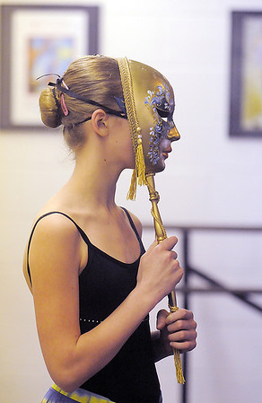 Olivia Neillands wears a gold mask as a puppet for Stromboli during rehearsal for the Danse Etoile Ballet production of Pinnochio on Monday.<br /> May 23, 2011<br /> staff photo/David R. Jennings