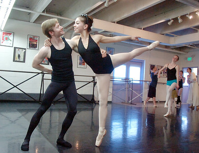 Christopher Darling dances with Alexandra Eddy during rehearsal of Danse Etoile's A Christmas Carol  at the studio on Saturday. More photos please see www.broomfieldenterprise.com December 10, 2011 Staff photo/ David R. Jennings
