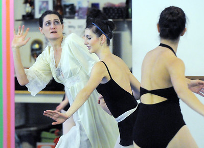 Scrooge played by Cecile Kyriakos shws fear as ghosts dance by her  during rehearsal of Danse Etoile's A Christmas Carol  at the studio on Saturday. More photos please see www.broomfieldenterprise.com December 10, 2011 Staff photo/ David R. Jennings