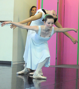 Meagan Knox, 13, front, and Alexandra Eddy, 16, perform a dance of the furture during rehearsal of Danse Etoile's A Christmas Carol  at the studio on Saturday. More photos please see www.broomfieldenterprise.com December 10, 2011 Staff photo/ David R. Jennings