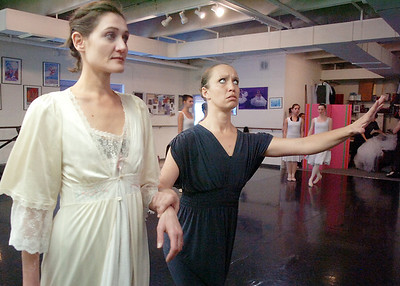 The ghost of the future played by Stacey Gibbs, right, escorts Scrooge played by Ceclie Kyriakos to the future during rehearsal of Danse Etoile's A Christmas Carol  at the studio on Saturday. More photos please see www.broomfieldenterprise.com December 10, 2011 Staff photo/ David R. Jennings
