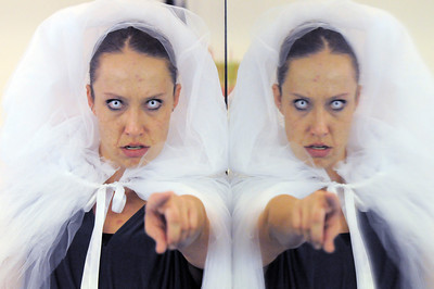 Stacey Gibbs as the ghost of Christmas Future poses at the mirror during rehearsal of Danse Etoile's A Christmas Carol  at the studio on Saturday. More photos please see www.broomfieldenterprise.com December 10, 2011 Staff photo/ David R. Jennings