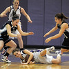 Holy Family's Sarah Talamantes smiles as she grabs a loose ball from Trinidad's Kendra Torrez and Justine Gallegos during the Class 3A sweet 16 game at Holy Family.<br /> March 5, 2011<br /> staff photo/David R. Jennings