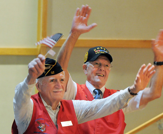 US Navy veterans Wayne Burt, left, and Jim Sparks give a cheer as their military service was honored during the Broomfield Veteran's Memorial Museum's annual Veterans Day ceremony at Broomfield High School.<br /> <br /> <br /> November 11, 2011<br /> staff photo/ David R. Jennings