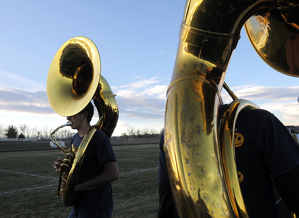 Legacy High Marching Band members Sami Meharzi, left, and Ryan Smith play the tuba during practice on the school's track for marching in the Macy's Thanksgiving Day Parade in New York City. <br /> November 10, 2011<br /> staff photo/ David R. Jennings