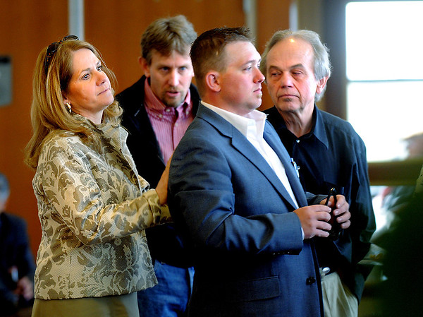 Travis Masse, right, waits with his lawyer Pamela Mackey, left,  and relatives for the jury's verdict in Masse's sexual assault trial at the Broomfield Combined Courts.<br /> April 29, 2011<br /> staff photo/David R. Jennings