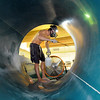 Lifeguard Carson Voss wears a mask to clean one of the water slides during the deep cleaning of the Paul Derda Recreation Center.<br /> <br /> August 24, 2011<br /> staff photo/ David R. Jennings