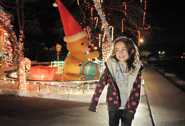 Jostyn Hillesheim, 6, looks at Kim Weibert's holiday lighting display at 1188 Clubhouse Drive.<br /> <br /> December 9, 2011<br /> Staff photo/ David R. Jennings