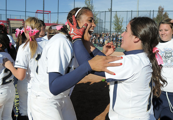 Legacy's Rainey Gaffin, left, celebrates with Jessica Ball after winning the state 5A championship defeating Brighton 4-1 at the Aurora Sports Park. This marks the 5th state softball championship in a row for the Lightning.<br /> October 22, 2011<br /> staff photo/ David R. Jennings
