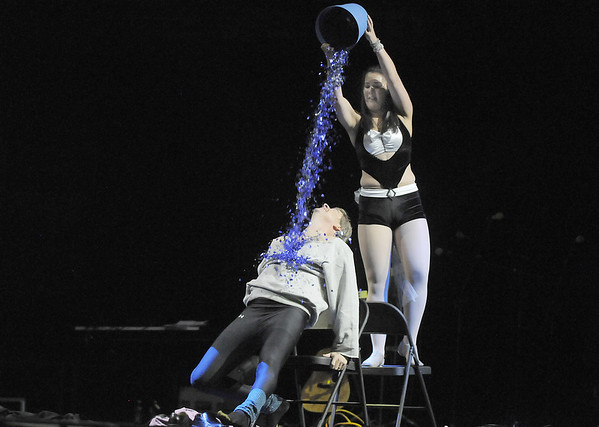 Carlee Taga (Taps 'N toes Dance Studio) dumps confetti on John Long during their winning dance at Dancing With The Broomfield Stars at the 1stBank Center.<br /> September 22, 2011<br /> staff photo/ David R. Jennings