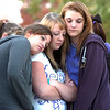 Hannah Harmon, 17, left, Halie Lower, 16, and Rachel Volesky, 16, friends of Kelsey Marie Shannon comfort each other at the dedication of Kelsey's Bridge on Lowell Blvd. in the Broadlands.<br /> October 14, 2011<br /> staff photo/ David R. Jennings