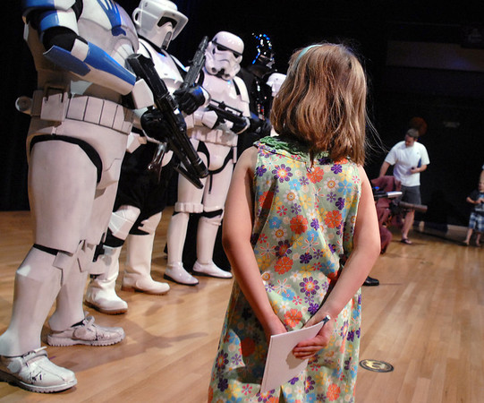 Ashley Acton, 5, waits to get autographs from members of the 501st Legion Mountain Garrison at the Star Wars fundraiser for the Broomfield Public Library Foundation at the Audi. <br /> <br /> August 7, 2011<br /> staff photo/ David R. Jennings