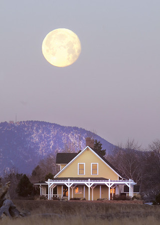 The full moon sets behind the Brunner Farmhouse.<br /> <br /> staff photo/David R. Jennings