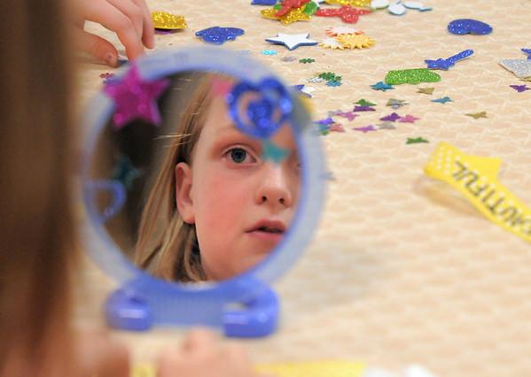 Joy Putnam, 10, decorates her mirror during the girls self esteem workshop led by Gracie Forrey at Broomfield United Methodist Church.<br /> July 26, 2011<br /> staff photo/ David R. Jennings