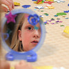 Joy Putnam, 10, decorates her mirror during the girls self esteem workshop led by Gracie Forrey at Broomfield United Methodist Church.<br /> July 26, 2011<br /> staff photo/ David R. Jennings
