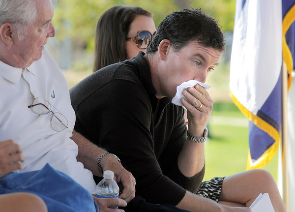 Michael Faughnan wipes away tears for his late brother Chris during the 9/11 Commemorative Ceremony at the 9/11 Memorial in Community Park. Chris Faughnan died in the World Trade Center attacks in 2001.<br /> September 11, 2011<br /> staff photo/ David R. Jennings