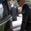Broomfield Police Chief Tom Deland gives end of watch call over the radio as the casket of detective Bruce Fitzgerald is loaded into the hearse during the funeral at Spirit of Christ Church in Arvada.<br /> May 12, 2011<br /> staff photo/David R. Jennings