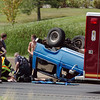 North Metro Fire paramedics treat an injured passenger after a single vehicle roll over accident on west bound U.S. 36.<br /> <br /> August 4, 2011<br /> staff photo/ David R. Jennings