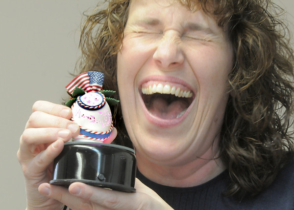 Egg artist Laura Schiller, at a Broomfield Art Guild meeting, laughs while showing a duplicate of the decorated and carved egg she made for First Lady Michelle Obama.<br /> April 16, 2011<br /> staff photo/David R. Jennings