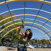 Regina Mata, 16, a New Vista High student, helps paint the equipment on a playground at Emerald Elementary School. <br /> October 16, 2011<br /> staff photo/ David R. Jennings