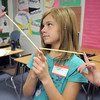 Dione Horne holds straws with fellow 6th graders and their 8th grade leaders as a getting aquainted game during Westlake Middle School's 6th grade orientation.<br /> August 11, 2011<br /> staff photo/ David R. Jennings