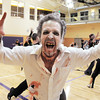 "Ean Biggs does a scary move while joining 100 ""zombies"" at the Paul Derda Recreation Center to perform Michael Jackson's Thriller dance as a fundriaser for A Precious Child.<br /> October 29, 2011<br /> staff photo/ David R. Jennings"