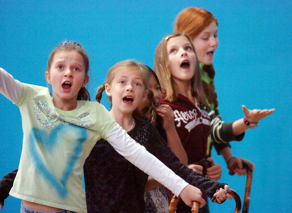 Actors Brooklynn Kirkpatrick, 9, left, Grace Nordgren, 10, Janelle Campbell, 10, Katie Blair, 12, and Kendall Ritger, 11, playing the elderly women sing a number during a rehearsal of the BackStory Theatre's Youth Theatre production of Bird Brains at the Broomfield Community Center.<br /> October 29, 2011<br /> staff photo/ David R. Jennings