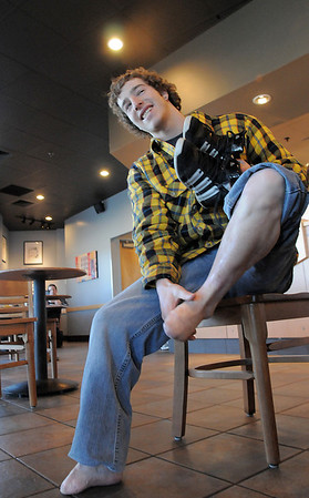 Starbucks employee Greg Bertram, 22, shows his feet that had all of the toes amputated as a child.  Bertram was given $1,100, raised by employees and customers of the Starbucks US 287, to help him get prosthetics for his feet.<br /> January 27, 2011<br /> staff photo/David R. Jennings